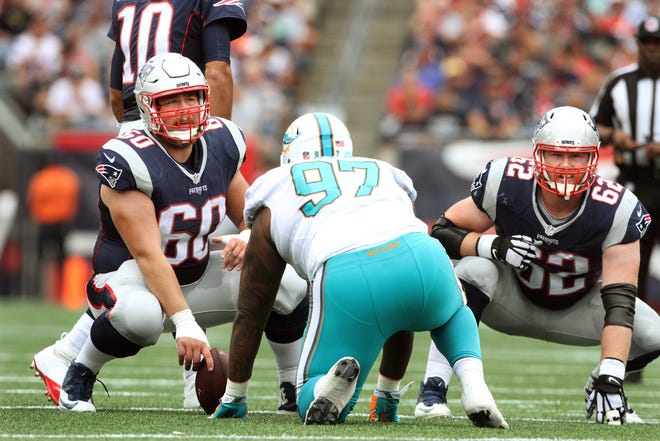 Patriots center David Andrews, left, and guard Joe Thuney helped form a solid middle of the offensive line but both are free agents this offseason.