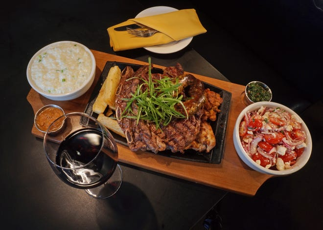 On the menu at the popular Los Andes restaurant is a churrasco-style platter with ribeye served with sides of  fried yucca and more.