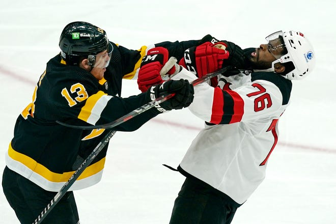 Bruins center Charlie Coyle (13) and New Jersey Devils defenseman P.K. Subban (76) grapple for position in the first period of Thursday's game in Boston.