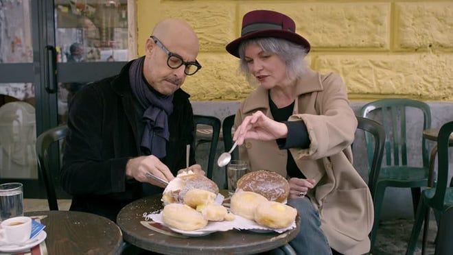 """Stanley assaggia doozy maritos, dolci panini lievitati con panna montata a Roma.  Nel secondo capitolo di """"Alla ricerca dell'Italia,"""" Ha visitato il Bar San Callisto a Roma con la sua amica Claudia della Fratina."""