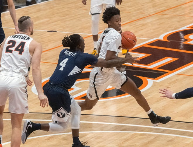 Pacific's Daniss Jenkins, right, drives on BYU's Brandon Averette during a WCC men's basketball game Feb. 18 at Spanos Center in Stockton.