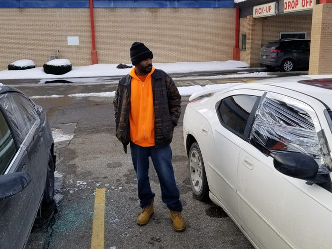 Kenneth Clax  looks at his car as he stands between it and his neighbor's car off Piedmont Avenue NE. Their cars were among dozens that have been vandalized in recent weeks. Police say most of the damage did not include theft.    Lori Steineck / The Canton Repository