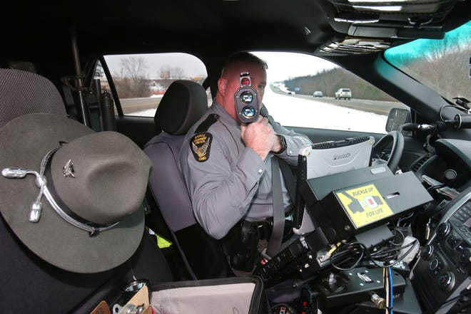 Ohio Highway Patrol Trooper Aaron Berry monitors traffic on U.S. Route 62 in Perry Township earlier this month. Despite COVID and stay-at-home orders, there were more drunken and drugged drivers on state highways last year.