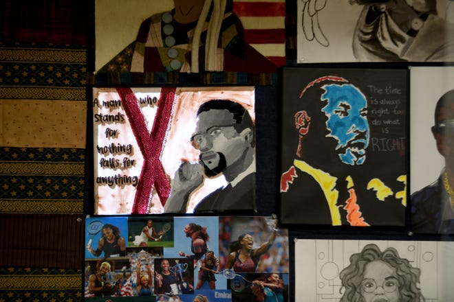 Perry High School art students created portraits of Black figures as part of a Black History Month display at the school. Using video mapping, the portraits come to life with a video projected over the artwork.