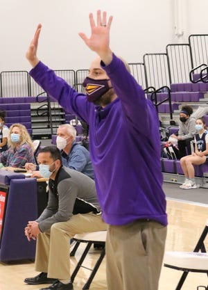 Hononegah coach Jason Brunke gives instructions to his team on Thursday at the Hononegah field house in Rockton.
