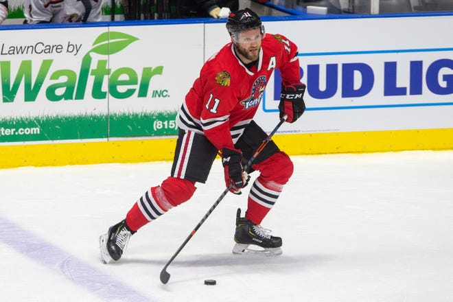 Rockford IceHogs' Cody Franson controls the puck against the Grand Rapids Griffins in the first period of their game at BMO Harris Bank Center on Thursday, Feb. 18, 2021, in Rockford. The Rockford Area Venues and Entertainment Authority, which owns the IceHogs, may sell the team to the NHL's Chicago Blackhawks.
