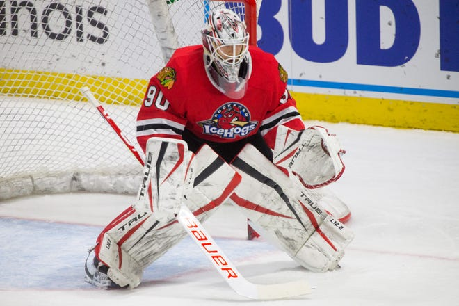 Rockford IceHogs' goalie Matt Tomkins watches the puck against the Grand Rapids Griffins in the second period of their game at BMO Harris Bank Center on Feb. 18 in Rockford. The Rockford Area Venues and Entertainment Authority is negotiating a possible sale of the team to the Chicago Blackhawks.
