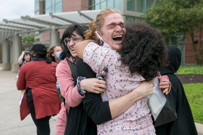 """William """"Sage"""" Gettings, arrested on July 31, is greeted by supporters outside the Winnebago County Criminal Justice Center on Monday, Aug. 3, 2020, in Rockford, after their release on a personal recognizance bond."""