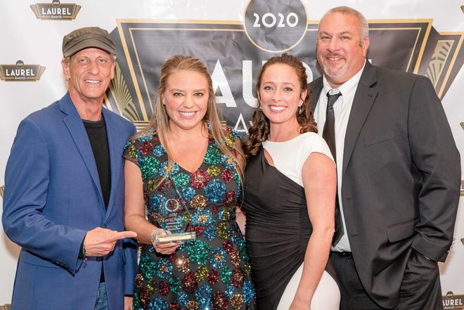 BBX Capital Real Estate received a gold Laurel Award for Best Community Website for Beacon Lake. Pictured are Bruce J. Parker (left), Jenn Kjellman, Danielle Simpson and Aaron Lyman.