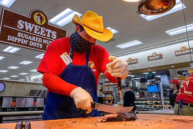 Sean Rasor cuts Texas-style brisket for sandwiches in the St. Augustine new Buc-ee's on Friday, Feb. 19, 2021. The store will open on Monday, Feb. 22.