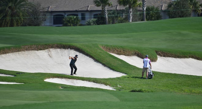 David Lingmerth of Tranas, Sweden, hits out of a sand trap in the fairway on the 581-yard, par 5, ninth hole, during the Korn Ferry Tour LECOM Suncoast Classic at Lakewood National Golf Club in Lakewood Ranch on Thursday.