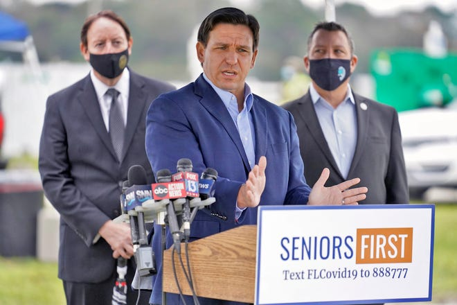 Florida Gov. Ron DeSantis speaks to the media at a coronavirus vaccination site at Lakewood Ranch on Feb. 17.