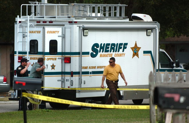 Manatee County sheriff's officials investigate the fatal shooting of two men in the 600 block of 61st Ave. Terrace East in southern Manatee County on Tuesday, Feb. 7, 2012.
