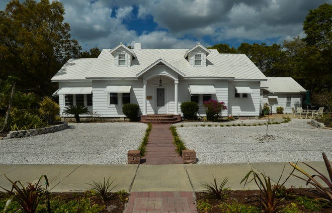 """A home on Fourth Street in the Gillespie Park neighborhood. Older residential neighborhoods in Sarasota have traditionally included small, separate residences, once characterized as """"granny flats"""" or """"mother-in-law suites."""""""