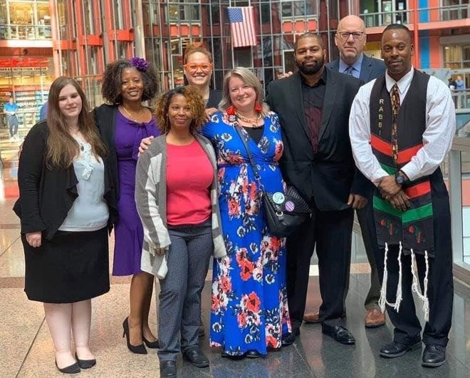 Norman Propst, third from right, stands with the Illinois Innocence Project group at an Illinois Prisoner Review Board hearing in Chicago in 2019. From left are Kaylan Schardan, a St. Louis University School of Law student; Dr. Tarece Johnson, co-founder of Alliance for Black Lives in Atlanta; Keisha Brown, co-founder of Alliance for Black Lives in Atlanta; Jen Nelson; Chelsea Clements; Probst; IIP Executive Director John Hanlon and Rabbi Michael Ben Yosef.