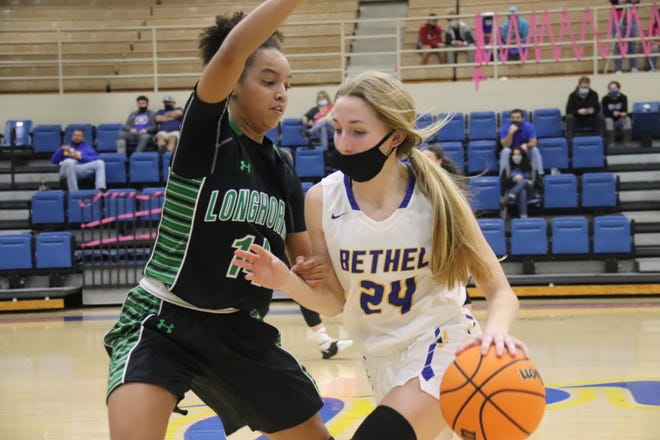 Bethel's Bella Thomas (24) dribbles the basketball against a Jones defender during a recent home game.