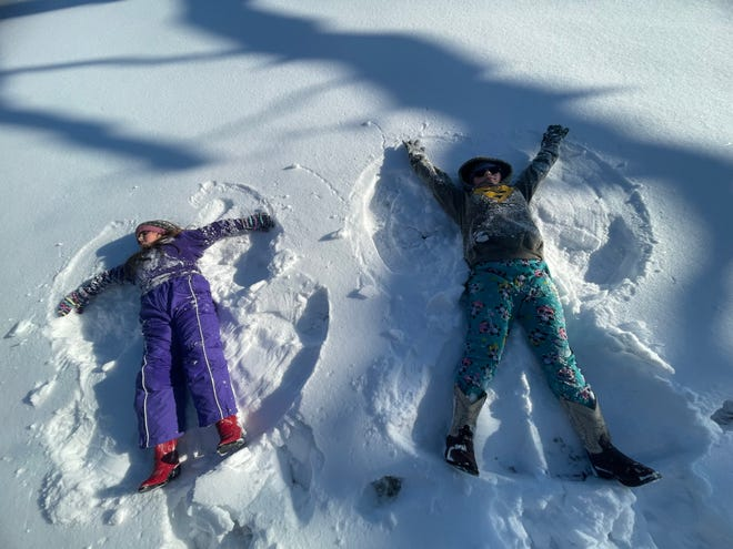 Kamdyn and Kynleigh enjoy the snow in Pottawatomie County and make snow angels.
