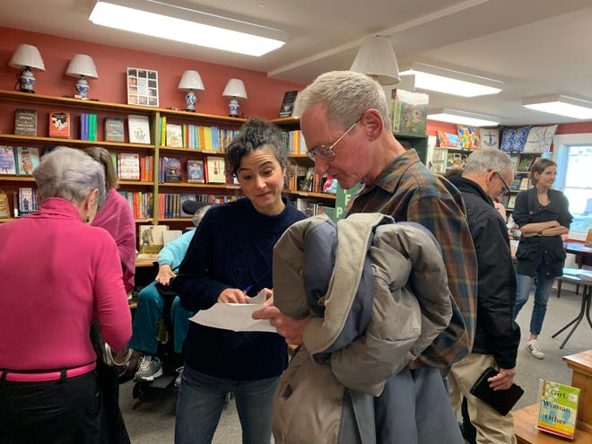 BookLovers columnist Lauren Daley chats with Century Club members last year at Partners Village store in Westport.