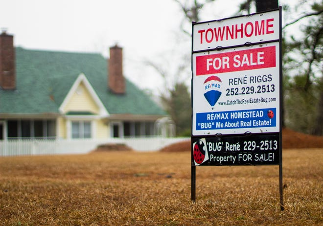 A real estate listing for a townhome in Carolina Pines is shown. The housing market continues to be a sellers market early into 2021. [Keith Byers/Sun Journal]