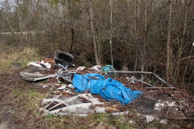 TRash like this is an all-too-common site in the Croatan and other forests and along rural roads in ENC.