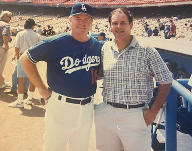 Ken Peak, right, with Bill Russell at an Aug. 31, 1997 L.A. Dodgers game.