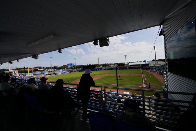Fans watch a spring training game between the Toronto Blue Jays and the Pittsburgh Pirates in Dunedin, Fla., on March 2, 2020.