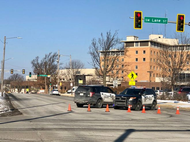 Topeka police blocked off S.W. 10th Street west of S.W. Lane Street on Friday morning after a fatal crash occurred at S.W. 10th and Washburn Avenue.