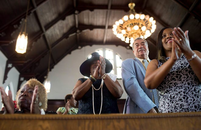 In this July 10, 2016, file photo, parishioners clap during a worship service at the First Baptist Church, a predominantly African-American congregation, in Macon, Ga. There are two First Baptist Churches in Macon — one Black and one white.
