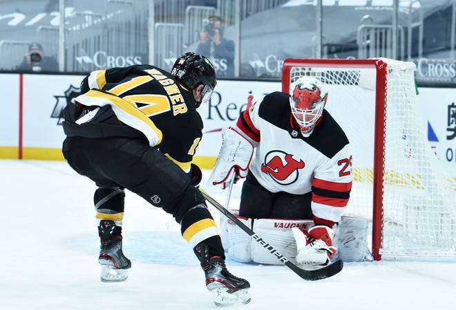 Devils goaltender Mackenzie Blackwood ties up the puck in front of Bruins right wing Chris Wagner during the third period Thursday night at TD Garden.