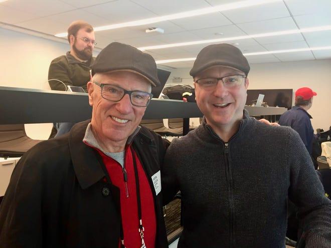 "Michael ""Doc"" Emrick and Joe McDonald (right) show off the scally caps."