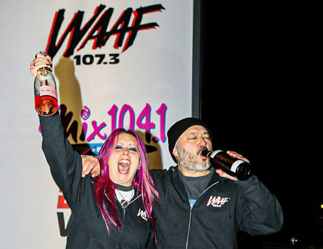 From left, WAAF radio personalities Mistress Carrie and Mike Hsu toast the radio station after signing off for the last time on Feb. 22, 2020.