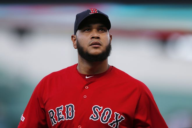 Boston Red Sox's Eduardo Rodriguez walks comes in from the bullpen before a baseball game against the Baltimore Orioles in Boston, Sept. 29, 2019. The left-handed pitcher missed all of last season and is rarin' to go this year for the Red Sox.