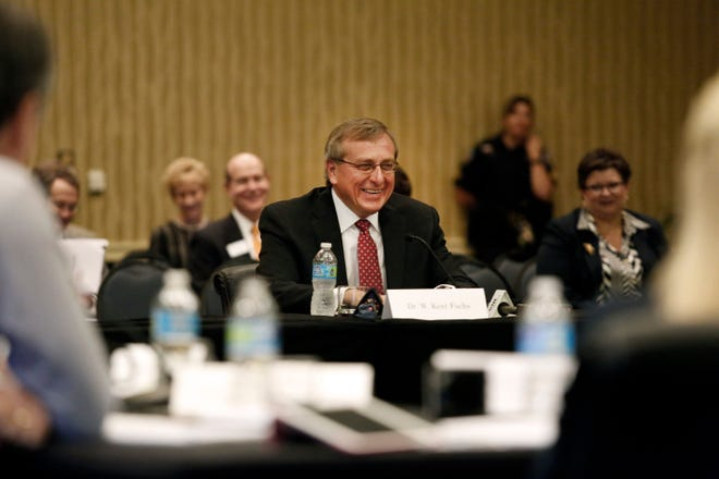 Members of the University of Florida's presidential search committee interview W. Kent Fuchs, who was then provost at Cornell University and would be hired as UF's president, at the UF Hilton Hotel and Conference Center in Gainesville in 2014.