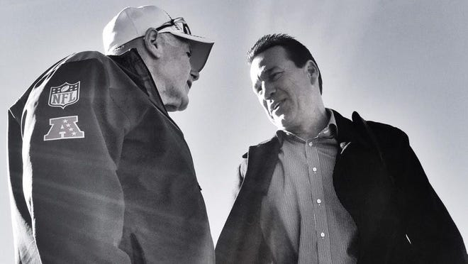 Broncos' Director of Special Services Fred Fleming talks with former Denver head coach Gary Kubiak. [www.scoopnest.com]