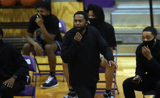 Africentric coach Michael Bates instructs his team during a game at Pickerington Central on Jan. 30. Because ofCOVID-19 protocols, the Nubians will not compete in the City League championship game or in the Division III district tournament.