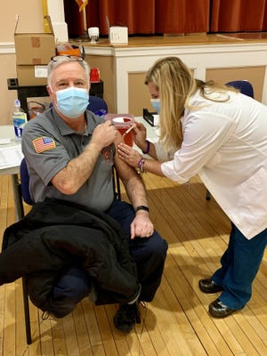 Braintree Fire Deputy Chief Steven Sawtelle receives the COVID-19 vaccine at Braintree Town Hall on Jan. 11.