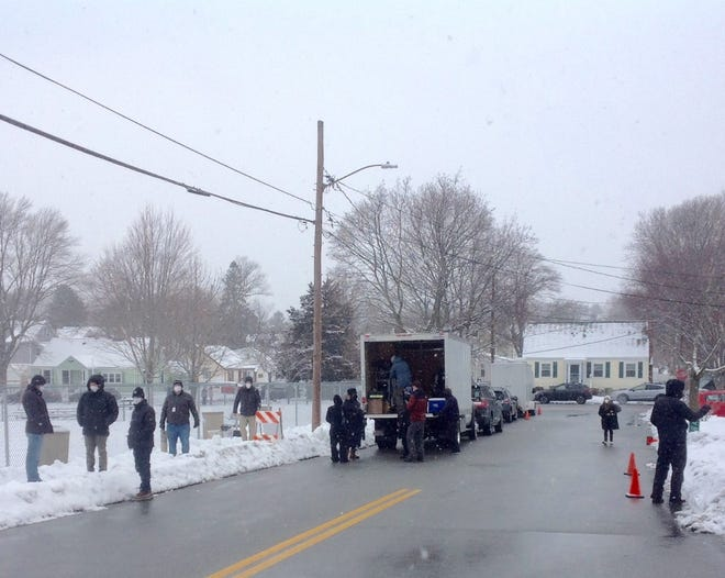 """On a recent snowy day, a film crew suddenly appeared to film """"Tender Bar,"""" directed by George Clooney and starring Ben Affleck, at Bemis Park in Watertown. Clooney is believed to be on the far left."""