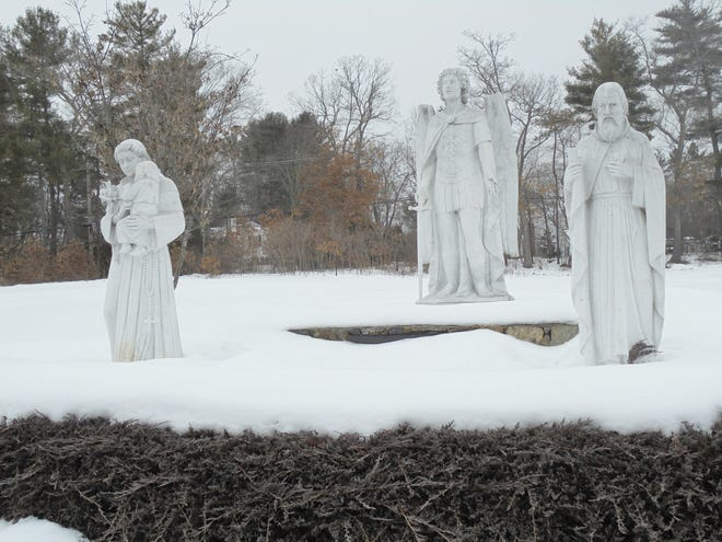 The donor of these statues of St. Anthony, St. Michael and St. Jude, in St. Michael's Cemetery, John R. Nelson, 77, was buried nearby on Feb. 19.  A former Bolton resident, Nelson and his family contributed to the expansion of the parish cemetery when his wife, Judith Nelson was interred there 17 years ago.