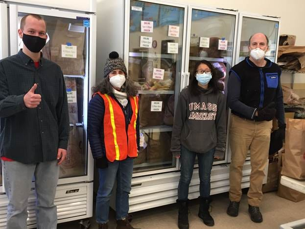 Groceries ordered through Open Table's new online ordering system are packed in new refrigerator/freezers. Pictured, from left: intern Nick Owen, Program Manager Jill Tsakiris, Comm Corps member Scarlett Cheung and Operations Manager Rob Slattery.