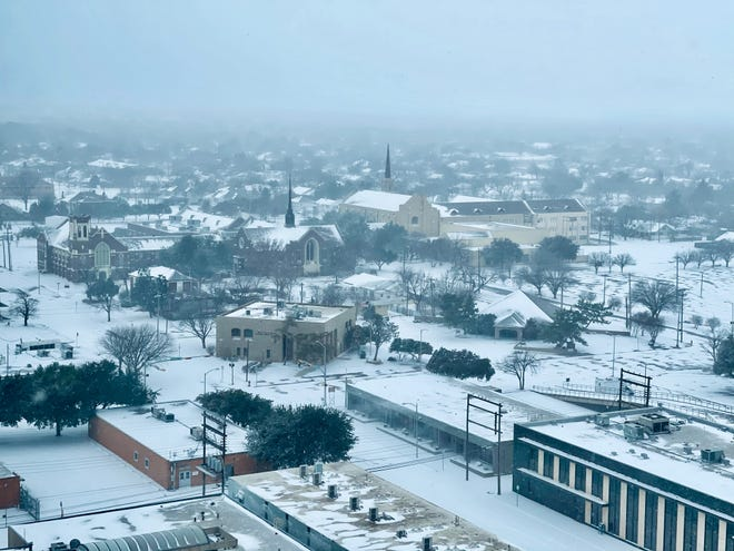 Snow falls on Cedar Street ... and more during winter storm Sunday. This view from the Hotel Wooten looks west with some downtown churches visible. Feb 2021