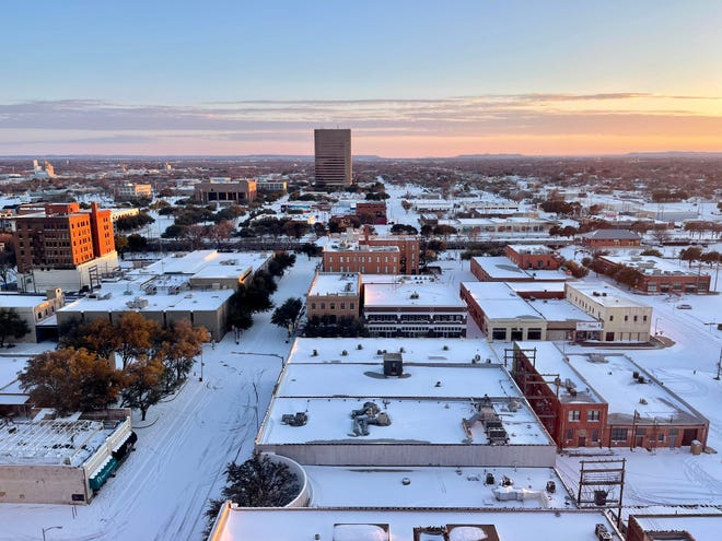 Sunset over snow-covered Abilene, as seen from the penthouse of the downtown Hotel Wooten, looking south toward the Enterprise Building.