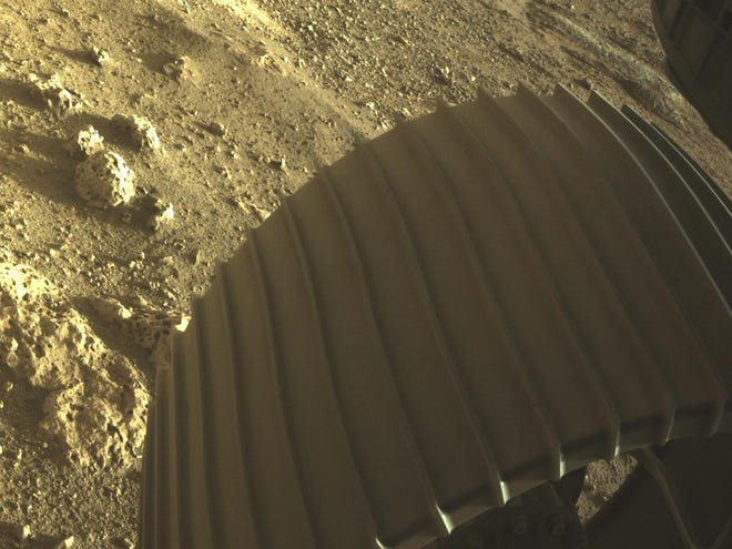 This high-resolution image shows one of the six wheels aboard NASA's Perseverance Mars rover, which landed on Feb. 18, 2021. The image was taken by one of Perseverance's color Hazard Cameras