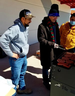 From the left, Moises Manzano, Mehmet Gurbuz and Ahmet Ege grill up burgers and sausages for faculty members at the School of Science and Technology Bayshore Campus on Friday, Feb. 19, 2021. Gurbuz, the school's principal, organized the cookout for the staff to help staff members who were struggling after last week's historic winter storm.
