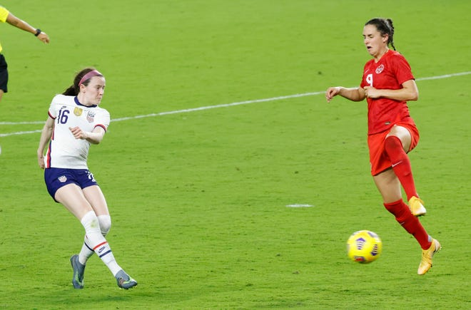 United States midfielder Rose Lavelle (16) kicks the ball into the net for the game-winning goal past Canada forward Evelyne Viens (9) during the second half of a She Believes Cup soccer match at Exploria Stadium in Orlando on Feb. 18.