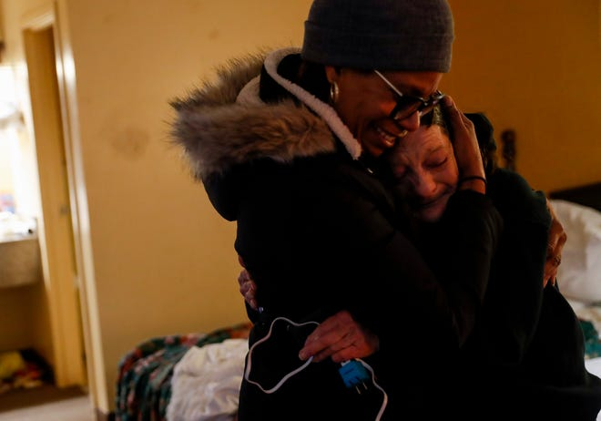 Cheryl, right, hugs Bridget Childs, left, after the volunteers from YaiPaks brought them their cellphones and other belongings retrieved from their old shelter that was bulldozed over two months ago at Winner's Circle Motel in Clarksville, Tenn., on Thursday, Feb. 18, 2021.