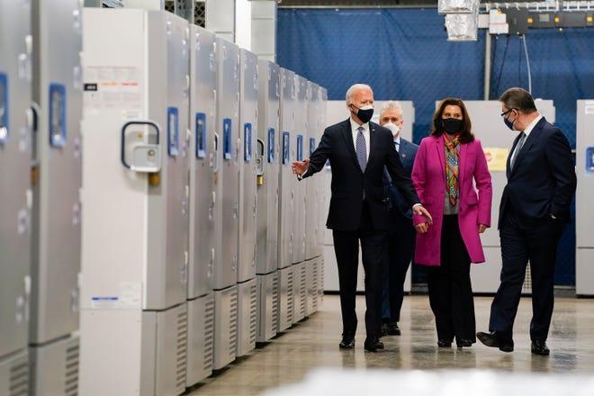 President Joe Biden tours a Pfizer manufacturing site Friday in Portage. From left, Biden, White House coronavirus response coordinator Jeff Zients, Michigan Gov. Gretchen Whitmer and Pfizer CEO Albert Bourla.