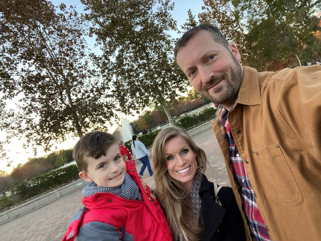 Bradley, Lindsay and Aaron Lewis, pictured here on December 20, 2020 in Houston, Texas, borrowed a 2021 Ford F-150 Hybrid truck with Pro Power Onboard from AutoNation Ford Katy to heat the house during the mid-February blackout.