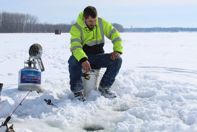 David Frost of Perrysburg was among dozens of ice fishermen at East Harbor State Park Wednesday, as continued sub-freezing temperatures kept the water frozen and a substantial ice cover near the park's kayak launch area.