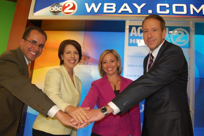 Steve Beylon, left, Kathryn Bracho, Tammy Elliott and Kevin Rompa are the morning newscast team at WBAY, Channel 2. Rompa will retire March 19 after 32 years at the station.