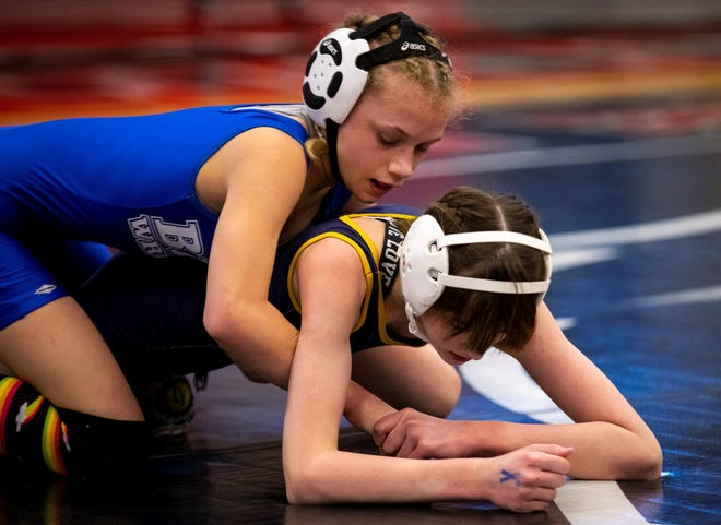 Great Falls' Kaylin Taylor, top, wrestles Missoula Big Sky's Justa Curtiss during the first day of the MHSA Girl's Wrestling State Tournament Friday at Lockwood High School.